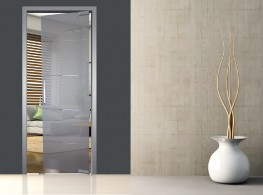 Door frame with architrave and extension for pivot glass door