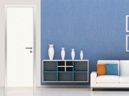 Door frame with architraves for hinged door